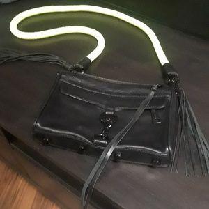 Rebecca Minkoff black purse with thick neon strap